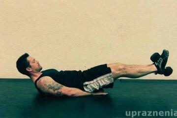 Подъем ног лежа на полу с отягощением